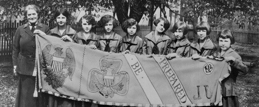Girl Scouts in vintage uniforms