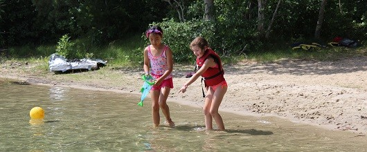 Girl Scouts outdoors at Camp Cedar Hill