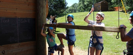 Girl Scouts on high ropes course